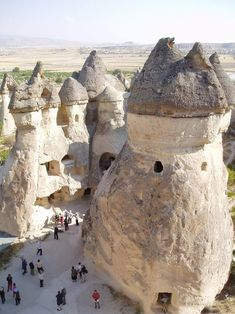 THE FAIRY CHIMNEYS of  Cappadocia in eastern Anatolia, in the center of TURKEY. The earliest record of the name of Cappadocia is from the late 6th century BC as one of the countries of the Persian Empire. People carved out houses, churches, and monasteries from the soft rocks of volcanic deposits. Göreme became a monastic center in 300—1200 AD. The first period of settlement goes back to the Roman period. http://en.wikipedia.org/wiki/Cappadocia