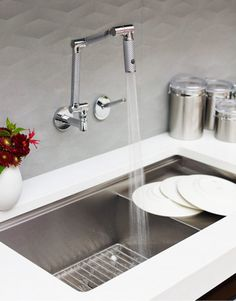 Kohler Sink and Twenty-four-inch-square Kariota backsplash tiles from Walker Zanger. Ceasarstone Pure White
