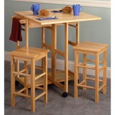 Winsome Wood 89330 Space Saver, Drop Leaf Table with 2 Square Stools Kitchen Dining Sets, Counter Height Dining Sets, Dining Room Sets, Dining Room Table, Dining Area, Kitchen Ideas, Table Stools, Kitchen Carts, Pub Chairs