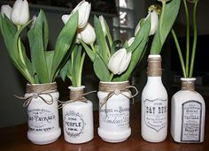 decoupaged glass jars using several of Graphic Fairy's free printable vintage labels