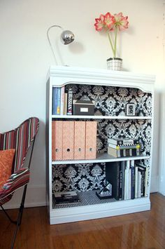 I did this with my bookcase, but just used wrapping paper and tape instead of wallpaper!