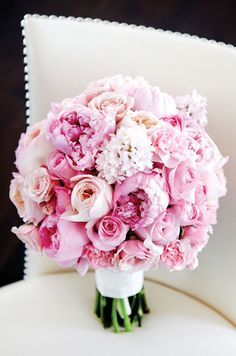 This gorgeous bouquet of pink peonies and garden roses is sure to capture everyone's attention. Tate Carlson Photographer