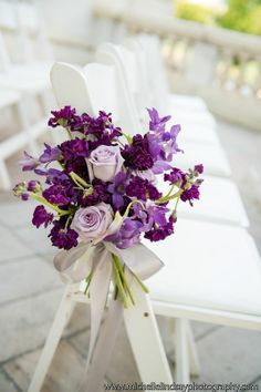 Lavender Roses with shades of purple stock for ceremony chairs.