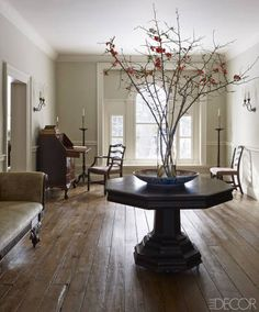 An 1840 center table, made in the region, was found at the Rhinebeck Antiques Fair, and the pine floor is original.