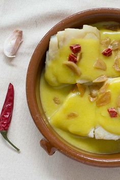 "Bacalao al pil-pil. Cod with ""pil-pil"" sauce: an emulsified olive oil sauce from the Basque Country. Cod in Pil-Pil sauce is a dish typical of Euskadi (North of Spain) and is well known all over Spain. Fish Recipes, Seafood Recipes, Mexican Food Recipes, Cooking Recipes, Healthy Recipes, Spanish Dishes, Spanish Food, Spanish Recipes, Spanish Christmas Food"