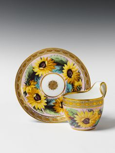 KPM (Berlin,Germany) — Cup and Saucer with sunflowers   on a pink ground, c.1810  (1300x1733)