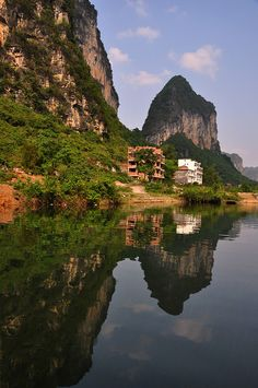 Yangshuo - China. It is indeed a backpacker town these days, but still worth seeing just for the scenery. Lots of rock climbing outside of town.