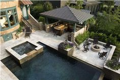 outdoor-kitchen-with-pool-and-dining-room.jpg 640×426 pixels