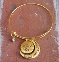 "Finders Keepers Creations, LLC - ""I Love You to the Moon and Back"" Gold Colored Bangle Bracelet, $7.99 (http://www.finderskeeperscreations.com/i-love-you-to-the-moon-and-back-gold-colored-bangle-bracelet/)"