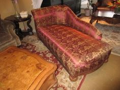 "Price: $399.99 Item #: 40162 A traditional chaise in a beautiful burgundy and gold print fabric with wood trim. This piece has such an elegant shape. It measures 74"" long x 36"" deep x 34"" high."