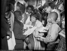 "Icon: Singer and actress Eartha Kitt signing autographs and surrounded by children for Citizens Committee on Hill District Renewal program, Hill District, May Photo by Charles ""Teenie"" Harris American Singers, American Actress, Eartha Kitt, Top 10 Hits, Kitten Love, Stand Up Comedians, Gone Girl, Sports Stars, Celebrity Photos"