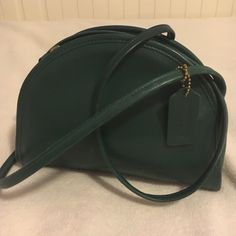 Vintage Forest Green Coach Crossbody Coach Classic half-moon Crossbody!! ✅ In good condition ➖Classic Collection ➖8 1/2 in long ➖ 6 1/2 in tall ➖2 in wide a little lighter on the bottom corner since its old, but unnoticeable detail ! (See pictures) Super cute! Coach Bags Crossbody Bags