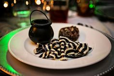 Striped pasta with alfredo in a little cauldron and steak roulade.  gourmet club {eat, drink, and BE SCARY}.  Halloween.  Photo by E Moon