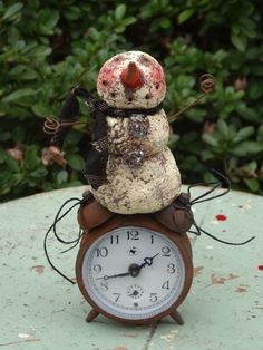 Paper Mache' Snowman on a Little Rusty Alarm by RockCreekEmporium