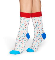 With sprinkles socks, it's party time all the time! With flecks in shades of blues and reds, these socks are lively and colorful. Topped with a red opening, a dark blue heel and a light blue toe, white sprinkles socks make every day a little more fun. These socks were woven from the finest strands of combed cotton to ensure lasting comfort and warmth. Pull on a pair for the greatest, coziest style around. Available in convenient sizes for women and men. Shades Of Blue, Red And Blue, Crazy Socks For Men, Blue Toes, Dark Blue Heels, Cotton, Colorful Socks, Cozy Fashion, Clothes