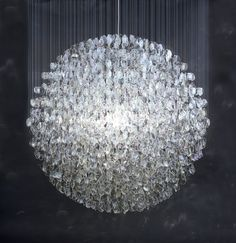 chandelier that's also a work of art.  created by artist stuart haygarth, and made entirely out of spectacle lenses - wow!