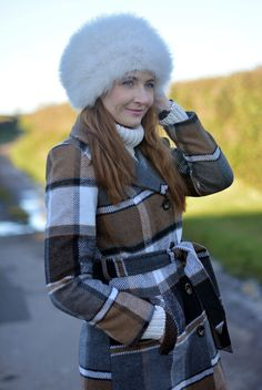 Winter neutrals: Oversized feather cossack hat and check coat