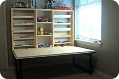 Work area (aka train table, lego table) folds up when not in use. bubblewrappd: The Tutorial. april 23 Also want in pretty white for craft room. Lego Storage, Table Storage, Craft Storage, Table Shelves, Jewelry Storage, Lego Table, Diy Table, Fold Out Table, Fold Up Desk