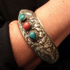 Silver, turquoises, corals, Nepal A splendid bracelet with animal and flower motives (dated from the sixties