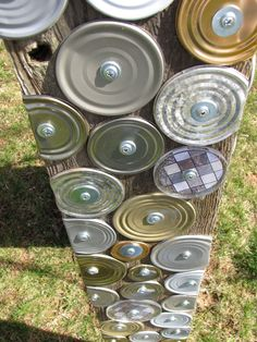 repurposed can lids, put on chicken run posts