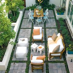 Planting strips of green between the concrete squares of your courtyard softens the space and adds interest. Plenty of comfy seating guarantees you'll enjoy your garden.