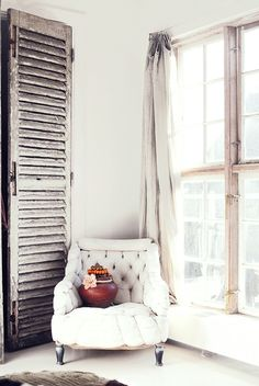 reading corner with drapes on wire.