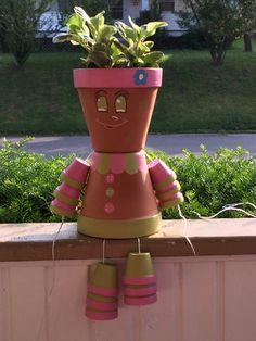 Clay flower pot girl