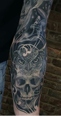 owl and skull forearm
