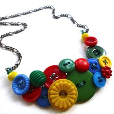 this would be a fun unique gift Funky Button Necklace in Primary Red, Yellow, and Blue plus Green by buttonsoupjewelry on etsy