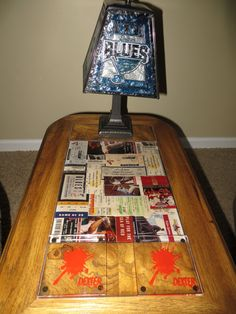 old ticket stubs under the glass part of a coffee table!