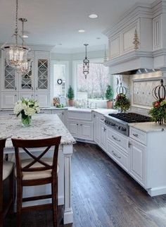 Lighting......... Lovely French Country Kitchen. Love the layout...empty island and sink looking out a window.