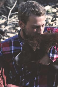 i don't know who this guy is... but plaid+puppy? marry me.