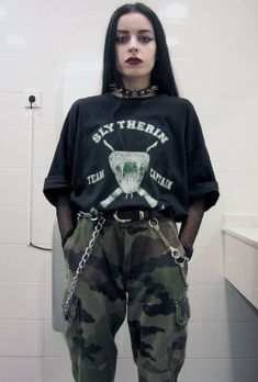 Spiked choker necklace with oversized printed top, fishnet top, belt & camouflage pants by tata70s