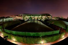 The outer courts are shown as night falls over the All England Lawn Tennis & Croquet Club. - Matthias Hangst/AELTC