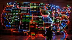 Electronic Superhighway  Nam June Paik. 1995 C.E. Mixed-media installation (49-channel closedcircuit video installation, neon, steel, and electronic components). It is an enormous physical object that occupies a middle ground between the virtual reality of the media and the sprawling country beyond our doors.