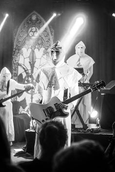 In the beginning, Ghost were called Ghost B.C., and they wore all white. They said that the costumes reminded them too much of the horrible KKK, so they switched to black. I love the black much better.
