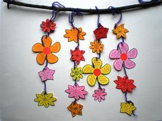 Lentetak met bloemetjes (je kunt ook kraaltjes tussen de bloemen doen om het nog leuker te maken)