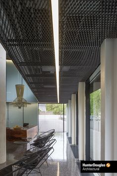 A black stretch metal ceiling by Hunter Douglas Architectural. : A black stretch metal ceiling by Hunter Douglas Architectural. Drop Ceiling Panels, Open Ceiling, Ceiling Light Design, Metal Ceiling, Ceiling Beams, Black Ceiling, Ceilings, Office Ceiling, Ceiling Decor