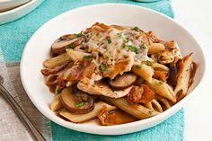 Tender chicken breast strips and sautéed mushrooms are added to a savory sauce and served with penne pasta in this quick and easy weeknight dish.