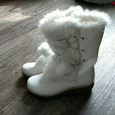 White boots So super cute! Warm fashion boots with faux fur, lacing, and poms. Side zip. Brand new. Just never got to wearing. Need to clear closet! Cherokee Shoes Winter & Rain Boots