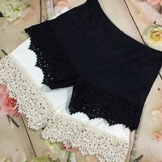"""SALE 37% OFF! Cream Lace Shorts Extenders Super soft short extenders featuring crochet lace trim and elastic waistband. Wear them under shorts, a skort, or a romper and add a little length and a lot of flair. They're so comfy you can even wear them to sleep! Listing is for one lace shorts extender Price: $34.00 comes in XS in Black only. Cream comes in small, Medium and Large BODY: 95% Rayon, 5% Elastane LACE: 100% Cotton XS 3"""" INSEAM, FITS 00-2 sold out S 3.5"""" INSEAM, FITS 2-4  M 4"""" INSEAM…"""