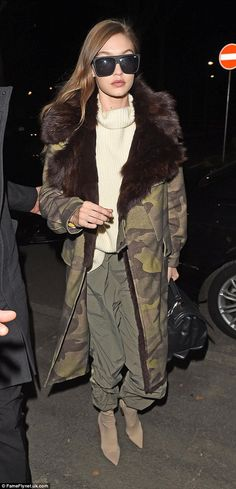 Fashionista: Gigi wrapped up in style with the statement outerwear which she teamed with a...