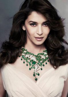 Bollywood diva Madhuri Dixit did a photo shoot for a special jewelry collection of emeralds from Zambia in Mumbai. Madhuri Dixit Saree, Preity Zinta, Elephant Jewelry, Jacqueline Fernandez, Cute Beauty, Queen, Indian Celebrities, Katrina Kaif, Bikini Pictures