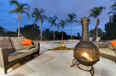 Outdoor tropical patio with fire pit and pool