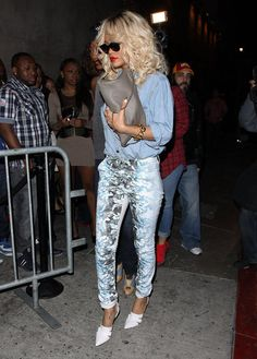 Rihanna in printed jeans and white pumps