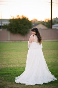 Amanda's Music Note Wedding Dress Embroidered with a Love Song - Avail & Company, LLC  Perfect bridal gown for a country fairy tale wedding!  The vintage style off-shoulder tulle gown has ruffled lace convertible straps.  Flowy style perfect for a beach or spring wedding.
