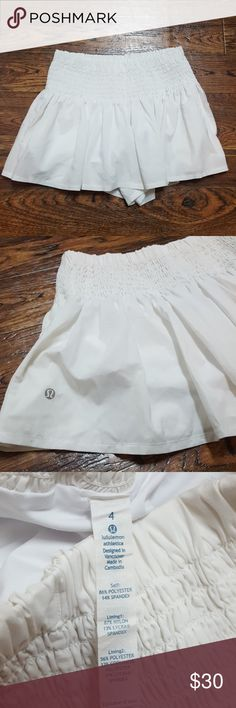 Lululemon Tennis Shorts Tennis shorts with elastic on bottom of shorts to prevent riding up as you move. 2 functional side pockets, off white in color. The look of a skirt, but shorts with flowy shorts over the top. lululemon athletica Shorts