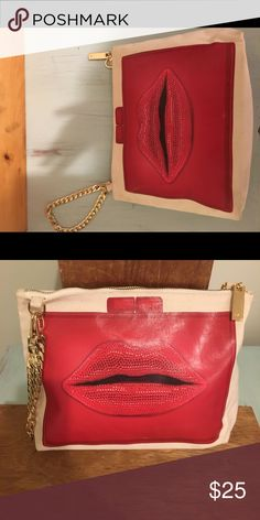 Canvas Thursday/Friday lips Clutch Awesome and brand new Thursday Friday Lips Clutch with gold chain wristlet  Perfect for night out or a makeup bag Thursday Friday Bags Clutches & Wristlets