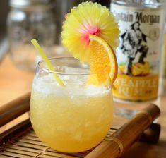 Puka Pineapple Punch: Lime Juice, Orange Juice, Pineapple Juice, Spiced Simple Syrup (recipe), Aged Jamaican Rum, White Rum, Pineapple Rum, Orange Wedge, Slice of Pineapple.