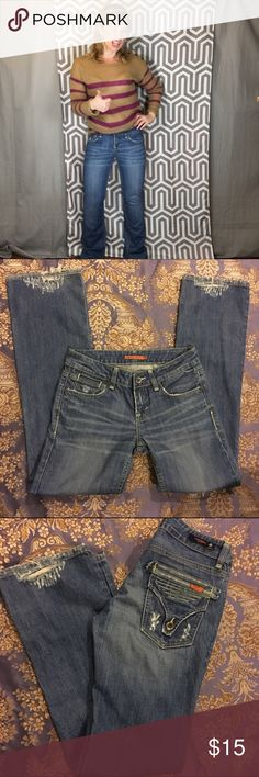 Vigoss Distressed Lowrise Bootcut Jeans Ripped into a cute pattern at the bottom of the legs- these Vigoss jeans are made for the back pocket-lover. Lowrise so make sure you don't have too much junk in the trunk like I do here or else you risk the dreaded muffin top. 32 Inseam. Vigoss Jeans Boot Cut
